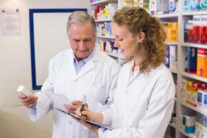 Pharmacists looking a medication for a prescription